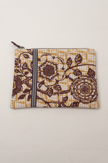 Anna Kaszer Polly pouch, geometric background in beige with yellow detail and brown flower print.