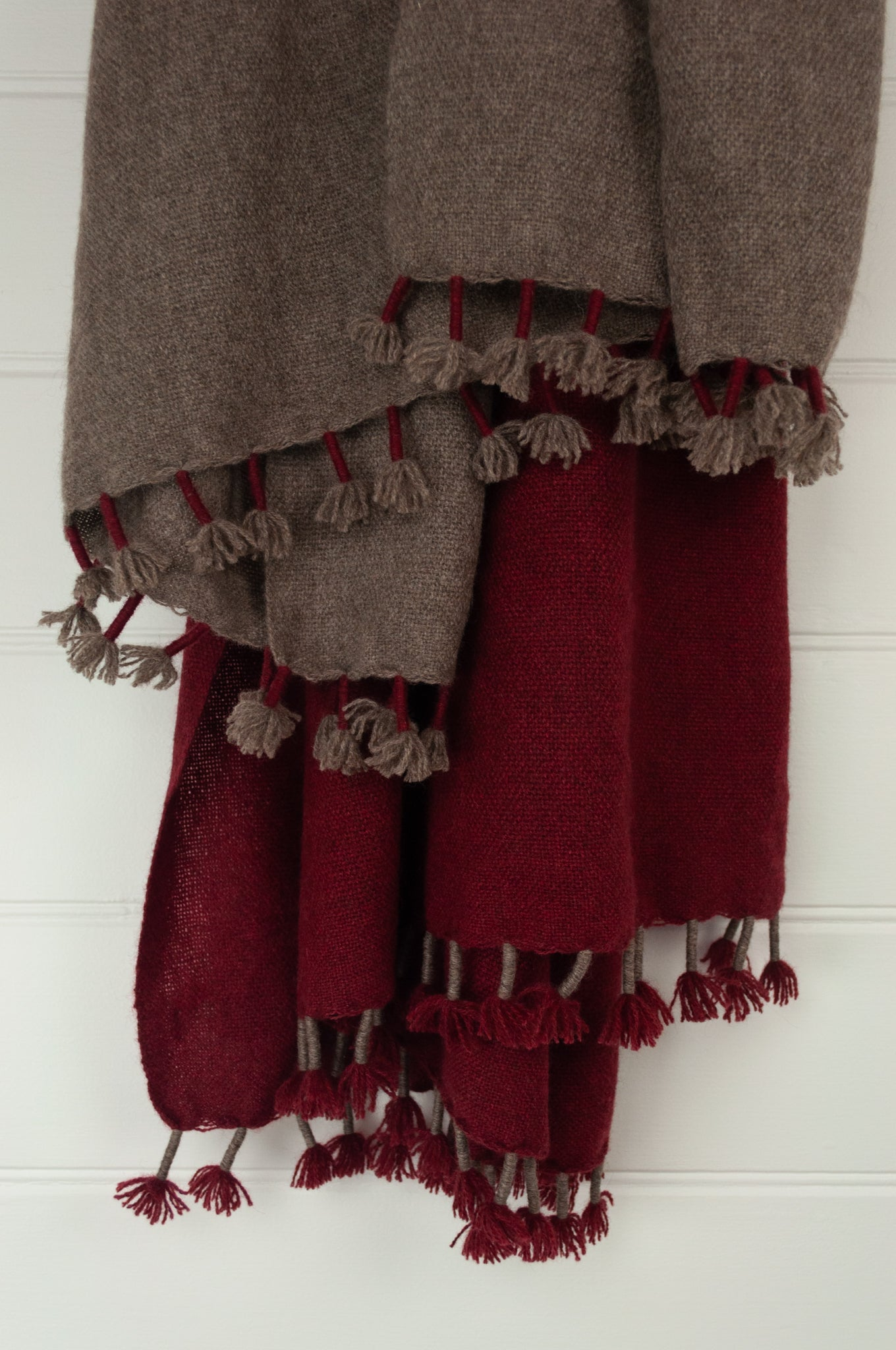 Baby yak wool handwoven tasseled throw rug in cherry red ombre fading to natural.
