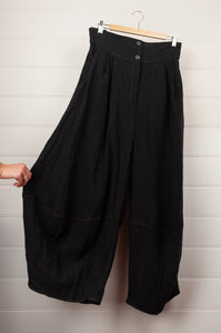 Kimberley Tonkin the label black linen bubble pants with flat front waist, elastic at back and rust contrast stitching.