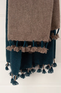Baby yak wool handwoven tasseled throw rug in teal green ombre fading to natural.