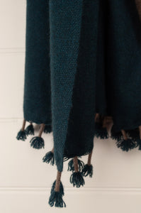 Baby yak wool handwoven tasseled throw rug in teal green ombre fading to natural (close up).
