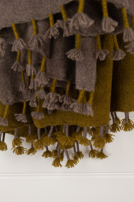 Baby yak wool handwoven tasseled throw rug in chartreuse green ombre fading to natural (close up).