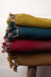 Baby yak wool handwoven tasseled throw rugs in chartreuse, teal, cherry and maize  ombre fading to natural.
