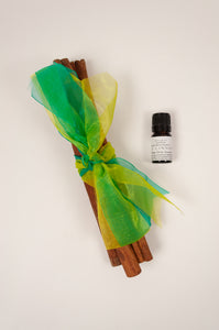 Juniper Hearth cinnamon stick bundles tied with brightly coloured organza ribbons. And sweet cinnamon oil.