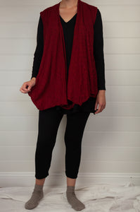 Valia Campbell tunic in black polyamide knit V neck A line loose fitting with side splits, layered with twist vest.