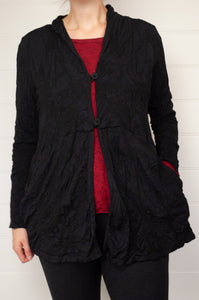 Valia Rosalind jacket wool polyamide stretch jacquard knit in black, two buttons, side pockets.