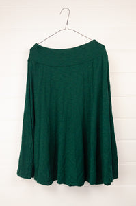 Valia six gores knee length emerald green skirt in wool polyamide knit.