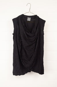 Valia long twisted vest in black wool polyamide knit.