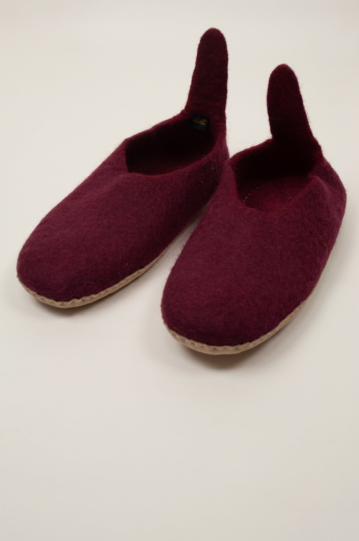 Juniper Hearth pure wool felt fair trade slippers pull on style in Burgundy red.