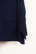 Load image into Gallery viewer, Banana Blue Poly Voly navy pullover roll neck top with asymmetrical hem and front patch pocket (pocket detail).