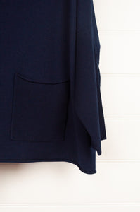 Banana Blue Poly Voly navy pullover roll neck top with asymmetrical hem and front patch pocket (pocket detail).