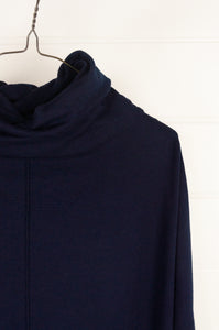 Banana Blue Poly Voly navy pullover roll neck top with asymmetrical hem and front patch pocket (neck detail).