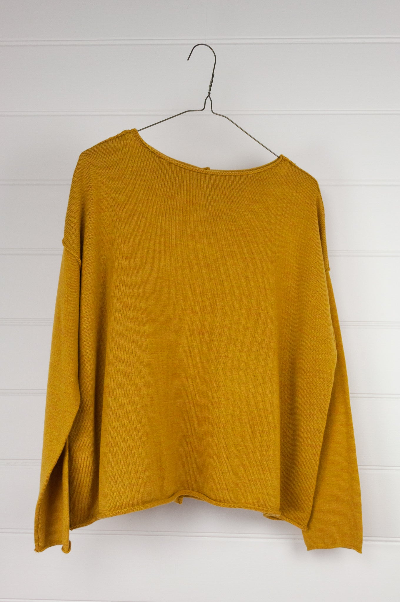 Banana Blue superfine merino wool knit jumper with button up back in mustard, with roll edges.