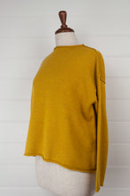 Load image into Gallery viewer, Banana Blue superfine merino wool knit jumper with button up back in mustard, with roll edges.