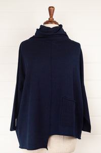 Banana Blue Poly Voly navy pullover roll neck top with asymmetrical hem and front patch pocket.