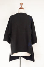 Load image into Gallery viewer, Banana Blue Poly Voly black side split pullover top in black with navy jacquard detail and high low hem.