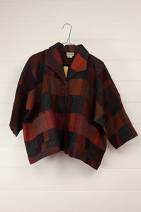Neeru Kumar classic Coco jacket in blanket checks in tones of red, burgundy, russet and charcoal.