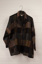 Load image into Gallery viewer, Neeru Kumar classic Egberta jacket in blanket checks in tones of deep brown and blue greys.