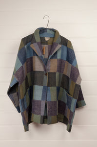 Neeru Kumar classic Egberta jacket in blanket checks in tones of blues and greens.