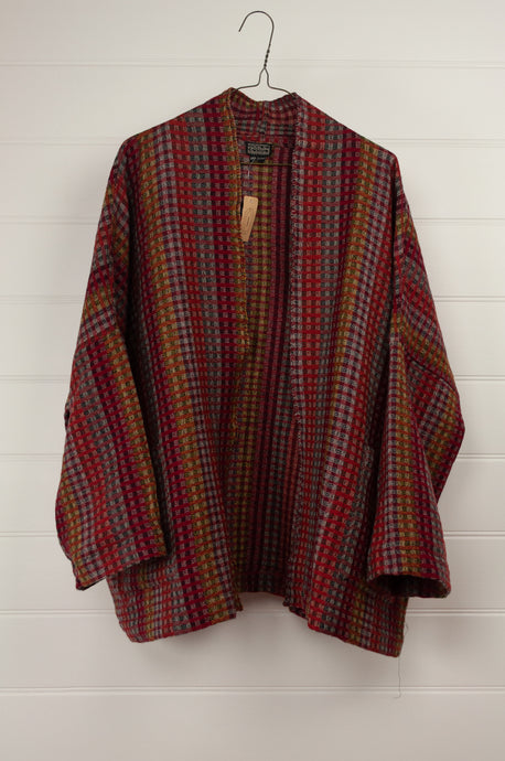 Neeru Kumar handwoven tweed check jacket in reds, mustards and charcoal.