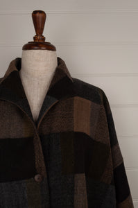 Neeru Kumar classic Egberta jacket in blanket checks in tones of deep brown and blue greys.