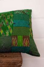 Load image into Gallery viewer, Vintage silk patchwork kantha bolster cushion, 30cmx60cm, in shades of emerald green, with ikat pieces and highlights of royal purple (detail).