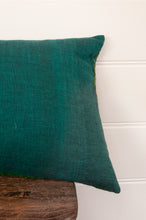 Load image into Gallery viewer, Vintage silk patchwork kantha bolster cushion, 30cmx60cm, in shades of emerald green, with ikat pieces and highlights of royal purple (rear fabric).