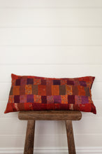 Load image into Gallery viewer, Vintage silk kantha bolster cushion, 30cmx60cm, in rich tones of burnt orange, cranberry red and deep pink.