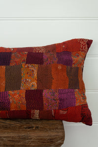 Vintage silk kantha bolster cushion, 30cmx60cm, in rich tones of burnt orange, cranberry red and deep pink.