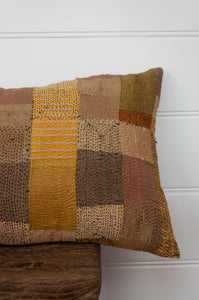 Vintage silk patchwork kantha bolster cushion, 30cmx60cm, is in spicy shades of mustard, saffron, gold, turmeric and olive (detail).