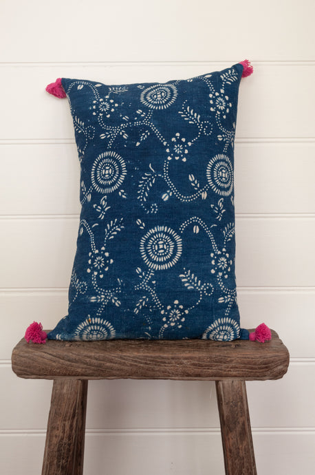 Vintage indigo blue and white cotton small 30x45cm bolster cushion with pink tassels.