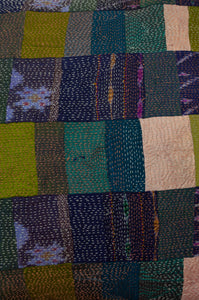 Vintage silk kantha square patchwork cushion in ecru, olive green and teal, with patches of navy ikat (close up)