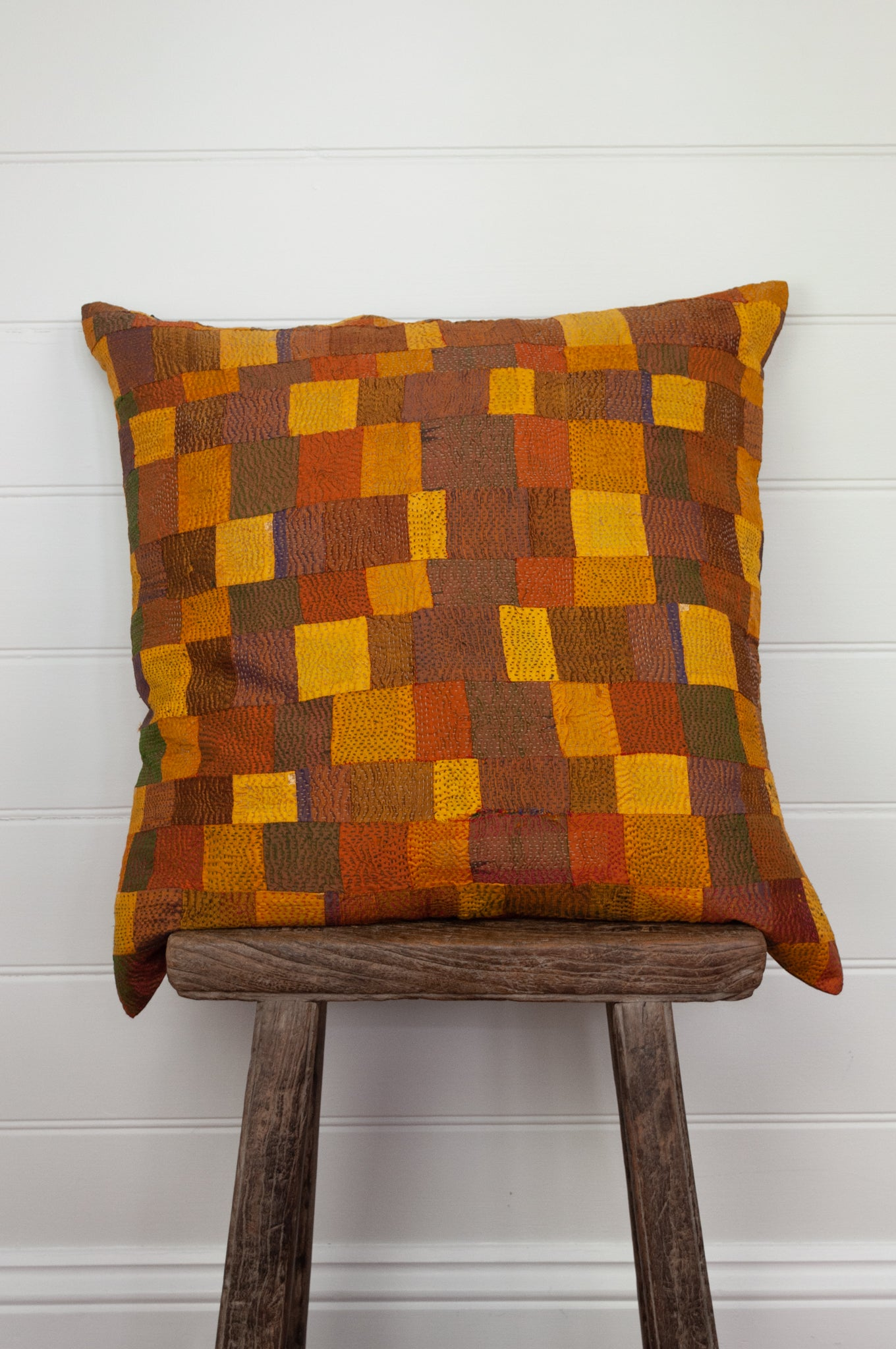 Vintage silk kantha square cushion with feather insert in shades of gold, mustard, olive and pumpkin orange.