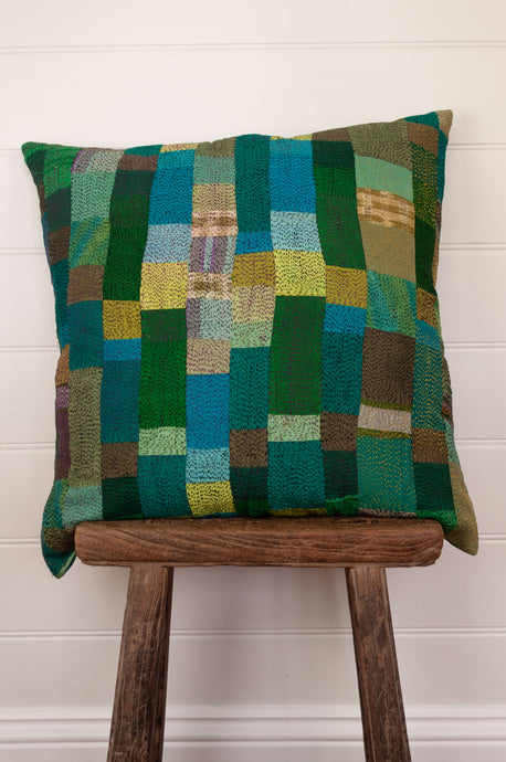 Vintage silk kantha square cushion is in shades of green, aqua, lime and sky blue.