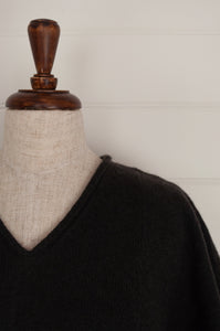 Juniper Hearth baby yak Mila sleeveless v-neck tunic in charcoal (close up, neck detail).