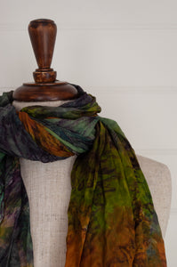 Juniper Hearth silk scarf, marbled digital print in jewel tones, amber emerald, sapphire, aquamarine.