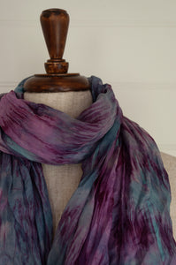 Juniper Hearth silk scarf, marbled digital print in shades of lilac, purple and highlights of blue.