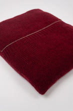 Load image into Gallery viewer, Juniper Hearth baby yak poncho in Cherry Red (close up, in pouch).
