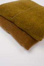 Load image into Gallery viewer, Juniper Hearth baby yak wool poncho in Weed, a deep yellow olive green shade and also in Maize (bottom). Close up, in pouches.
