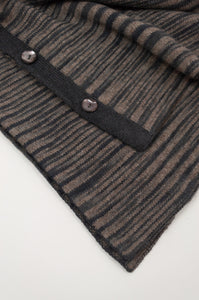 Juniper Hearth baby yak wool poncho in natural and charcoal ikat design (close up).