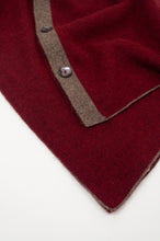Load image into Gallery viewer, Juniper Hearth baby yak poncho in Cherry Red (close up).