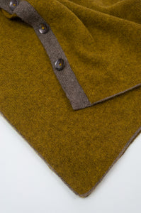 Juniper Hearth baby yak wool poncho in Weed, a deep yellow olive green shade (close up).