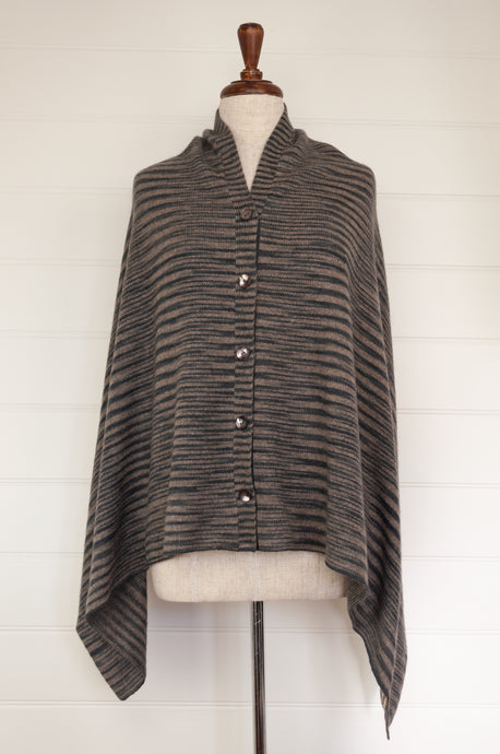 Juniper Hearth baby yak wool poncho in natural and charcoal ikat design.
