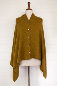 Juniper Hearth baby yak wool poncho in Weed, a deep yellow olive green shade.