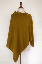 Load image into Gallery viewer, Juniper Hearth baby yak wool poncho in Weed, a deep yellow olive green shade.