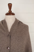 Load image into Gallery viewer, Juniper Hearth baby yak wool poncho in natural with grey edge and binding (close up).