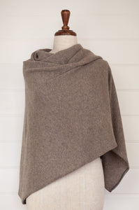 Juniper Hearth baby yak wool poncho in natural with grey edge and binding.