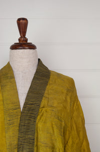 Neeru Kumar long kimono jacket in shibori dyed silk, gold with charcoal highlights, cotton lining, lightly quilted (closeup).