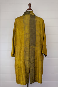 Neeru Kumar long kimono jacket in shibori dyed silk, gold with charcoal highlights, cotton lining, lightly quilted (rear).