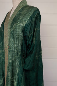 Neeru Kumar long kimono jacket in shibori dyed silk, green with latte highlights, cotton lining, lightly quilted (detail).